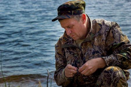 A man is busy choosing pike bait Reklamní fotografie