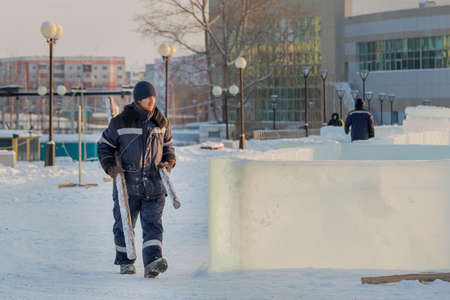 Portrait of a worker engaged in arranging an ice town