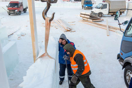 Installers are building an ice town of ice blocks