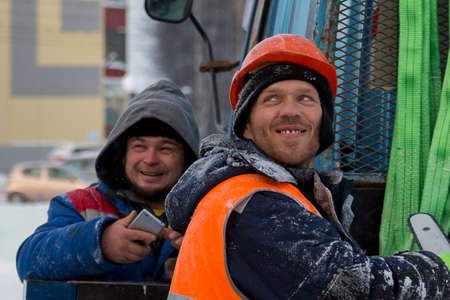 Workers on the construction site of the ice town in a good mood Reklamní fotografie