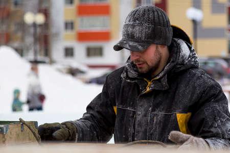 Portrait of an assembler worker in a sports hat in black Stock Photo