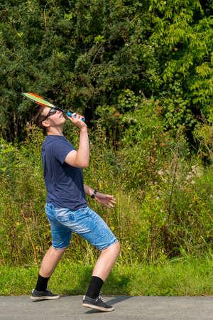 Teen boy with a racket in hand plays badminton Zdjęcie Seryjne