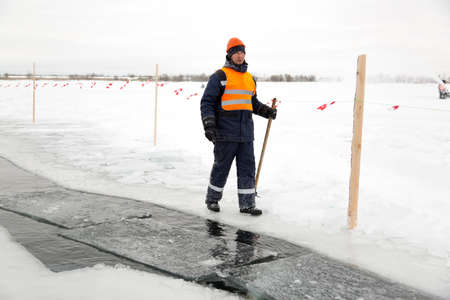 lake with bogr in his hand on ice mining