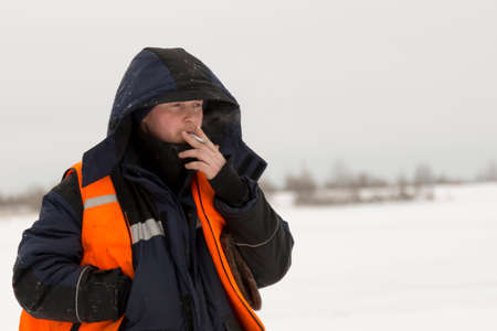 Portrait of a worker in a blue jacket with a hood on his head Stockfoto
