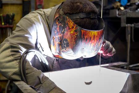 TIG welder performs welding repair of the engine pallet