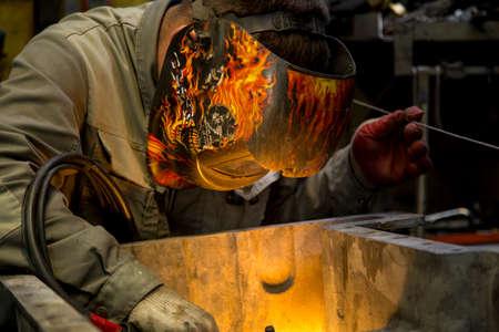 TIG welder performs welding repair of the engine pallet Foto de archivo