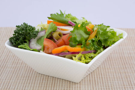 Bowl of healthy green garden salad with fresh vegetables