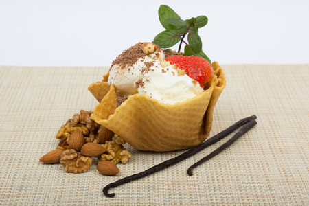 Vanilla ice cream in a wafer basket with nuts