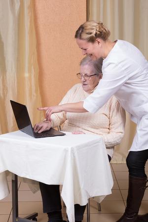 80 plus adult: Elderly woman using a laptop computer Stock Photo