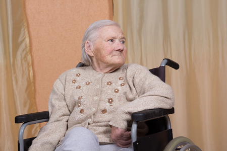 Eighty year old woman sitting in a wheelchair Stock fotó