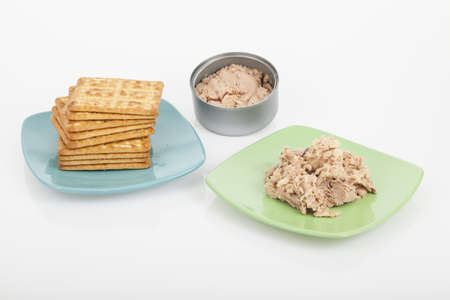 Cookies of salt with canned tuna; photo on white background.