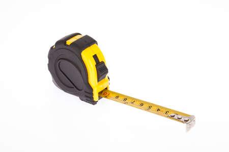 Yellow flexometer with black on white background. Stockfoto