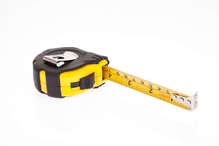 Yellow flexometer with black on white background. 免版税图像