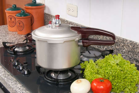 Pressure cooker; photo about stove in the kitchen.