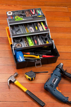 plastic box to organize tools; photo on wooden background.
