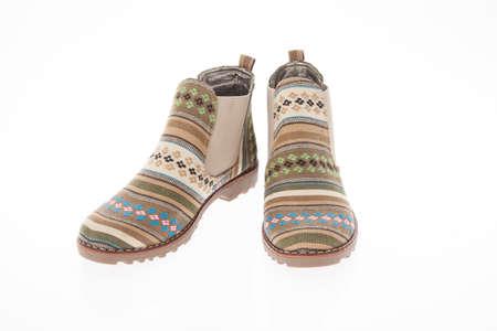 Boot shoes made of fabric with floral patterns for women's on white background.