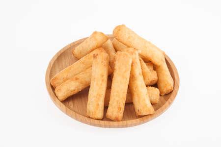 Tasty fried cassava sticks; photo on white background.