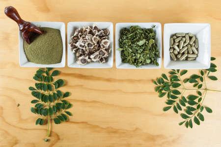 Moringa nutritional plant Seeds, leaves, capsules and powder - Moringa oleifera Stock Photo