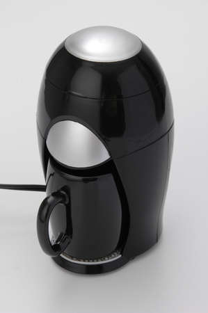 Modern coffee maker; machine to prepare one cup of coffee.