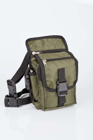 Small bag for men; made of green fabric.
