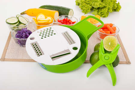 Home kitchen; Grater food processor, photo on neutral background.
