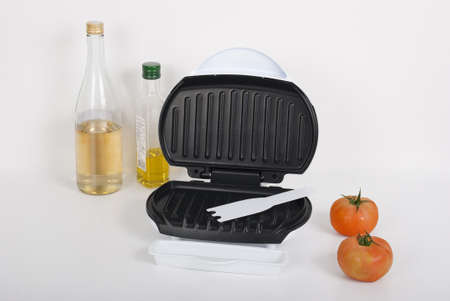 Household kitchen utensils; Machine to make panini. Stock Photo