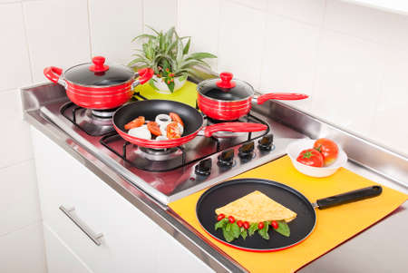 Cookware; Set of cooking pots.