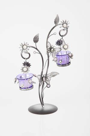 wrought iron candlestick on white background. Stock Photo