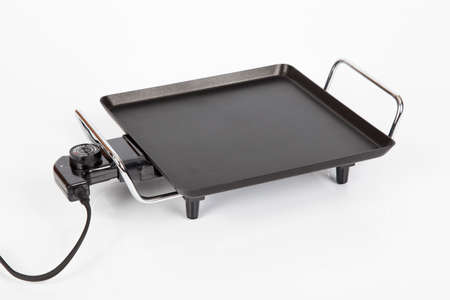 Electric griddle for cooking; photo on white background.