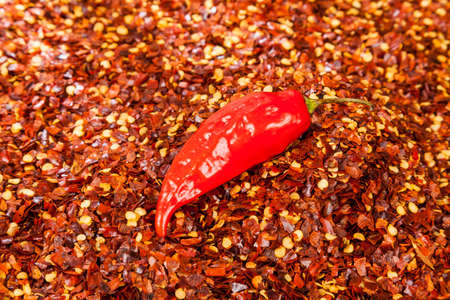 Red pepper or cayenne; Pepper crushed with flakes scattered.