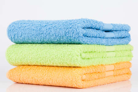 Set of three towels in different colors.; photo on white background.