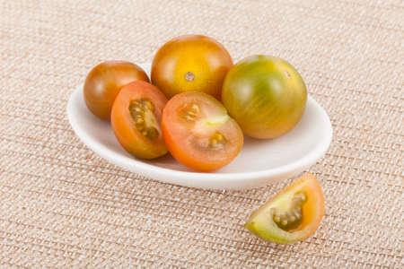 Bowl with cherry tomatoes - Solanum pimpinellifolium.
