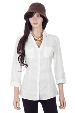 Female mannequin dressed with white blouse and hat on white background. Imagens