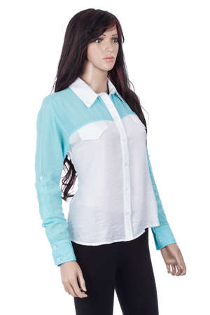 Female mannequin dressed with white and blue blouse on white background. Zdjęcie Seryjne