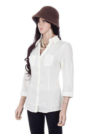 Female mannequin dressed with white blouse and hat on white background. Zdjęcie Seryjne