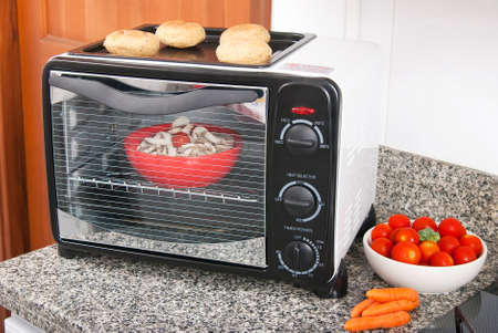 Household appliance; toaster oven, photo in kitchen environment.
