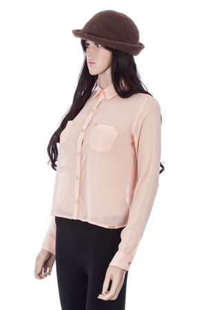 Female mannequin dressed with pink blouse and brown hat on white background.
