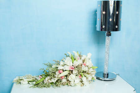 Bouquet of flowers on the nightstand