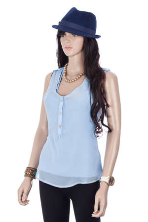Female mannequin dressed with blue blouse and hat on white background. Imagens