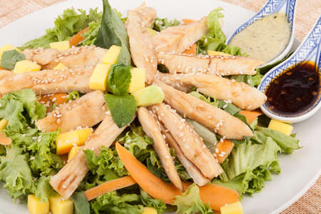 Healthy food; tasty lettuce salad with chicken grilled.