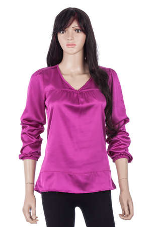Female mannequin dressed with blouse of fabric satin purple on white background.