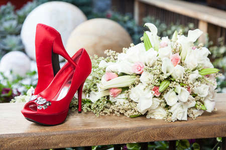 The bouquet and shoes bride for wedding