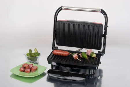 Open panini machine; Photo on neutral background. Imagens