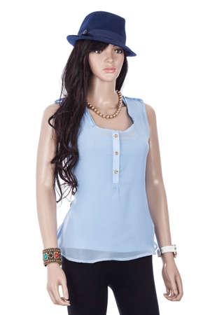 Female mannequin dressed with blue blouse and hat on white background. Zdjęcie Seryjne
