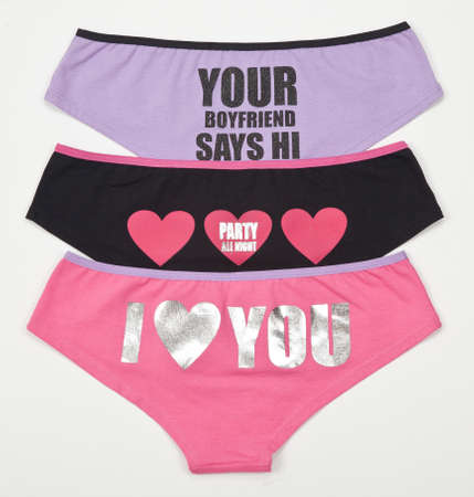 Ropa interior; Set Of Three Panties For Women, Photo On White Background.