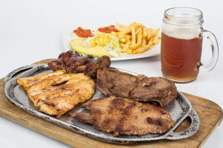 Food; Three different roast meats, with salad, french fries and a drink.