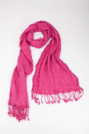 Pink Scarf Woven With Fringes On White Background. Imagens