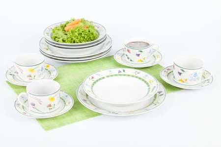 White Modern Dishes With Figures Flowers Shapes.