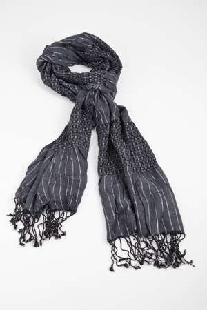 Gray Scarf Woven With Fringes On White Background.