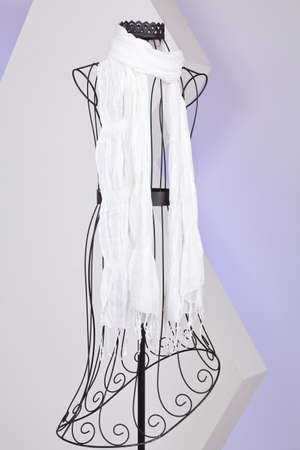 White Scarf Woven With Fringes On Mannequin.